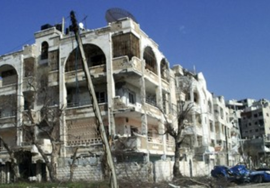 Damaged houses, vehicles in Homs, Syria