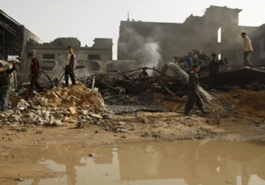 Palestinians pass rubble from IAF strike, Gaza