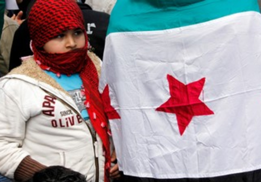 Child near Syria opposition flag