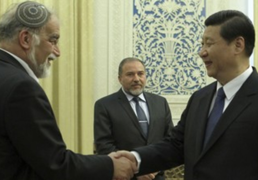 Liberman looks on as Chinese VP greets Rotem
