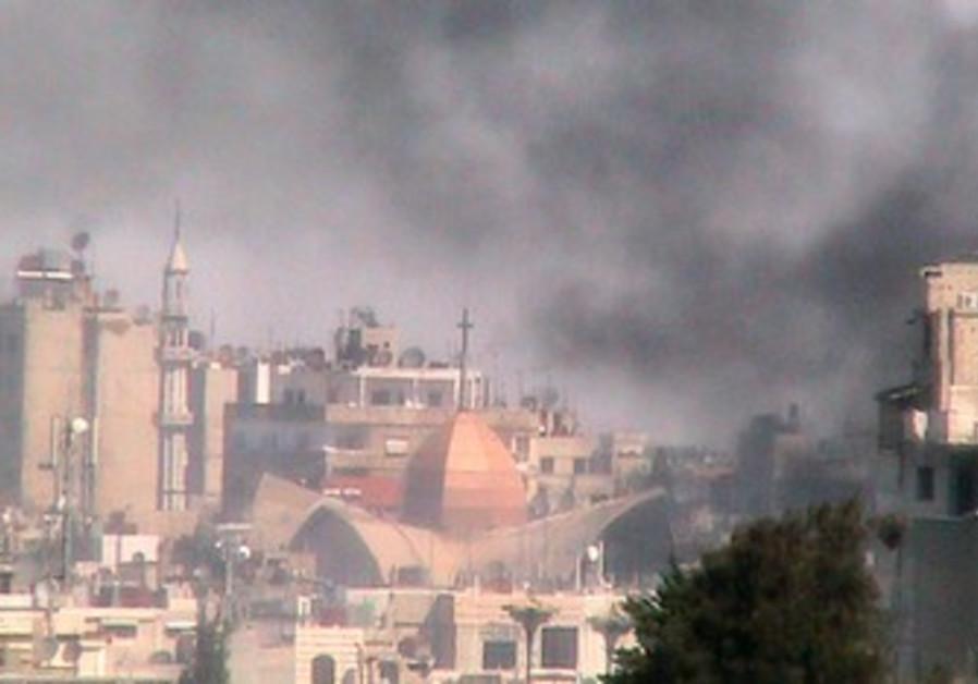 Smoke rises from Bab Sabaa neighborhood of Homs