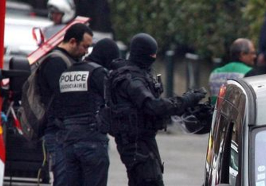 French police in raid on Toulouse shooting suspect