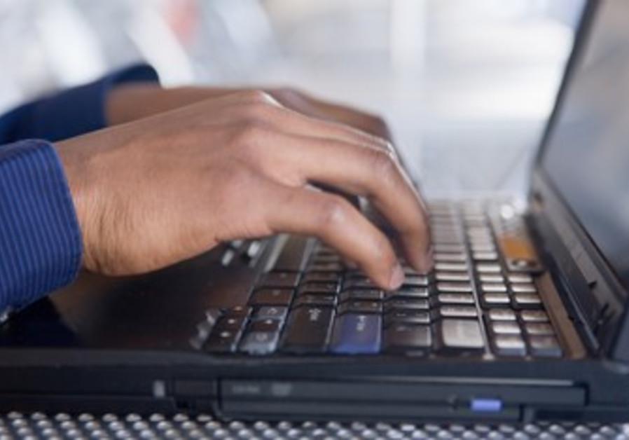 Man types on a computer [illustrative photo]