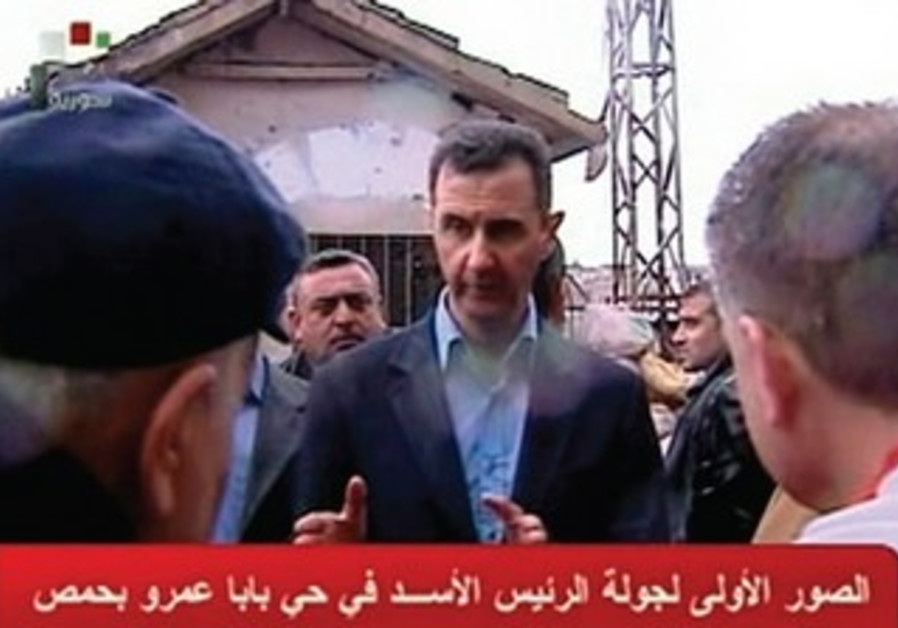 Assad visits Homs