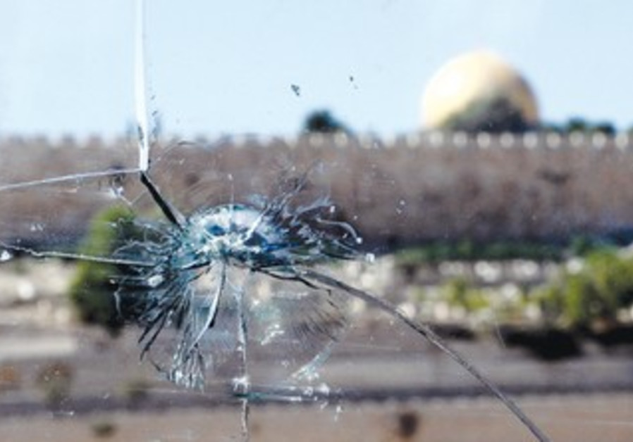 bullet hole in a car windshield in east Jerusalem