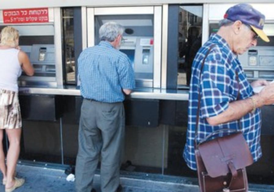 People make transactions at Bank Hapoalim ATM