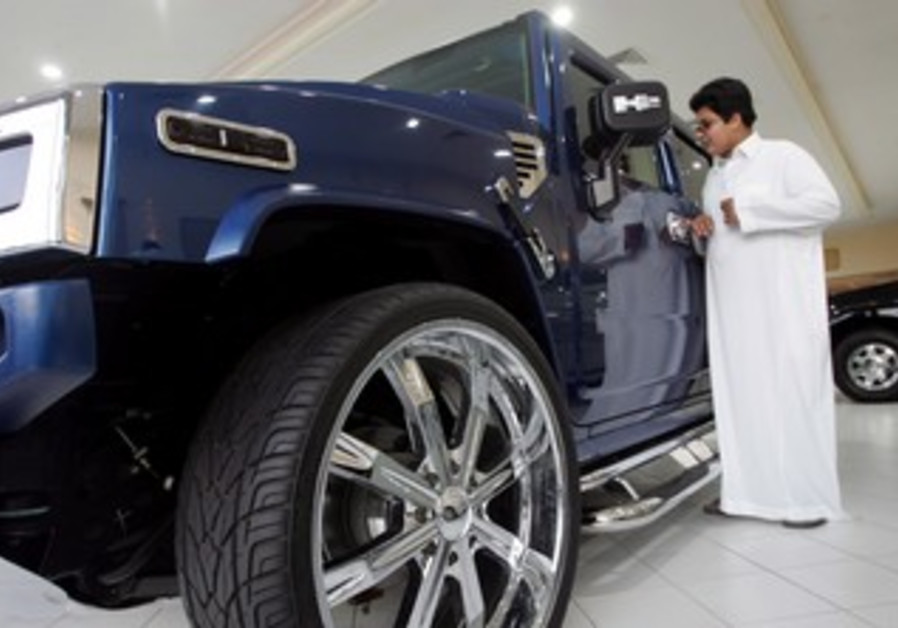 Saudi man in a car showroom