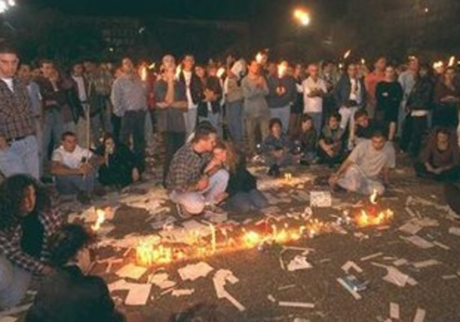 Teenagers gather after assassination of Rabin