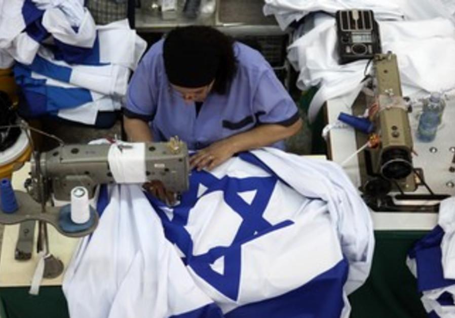Preparing flags at the Kalman Berman flag factory
