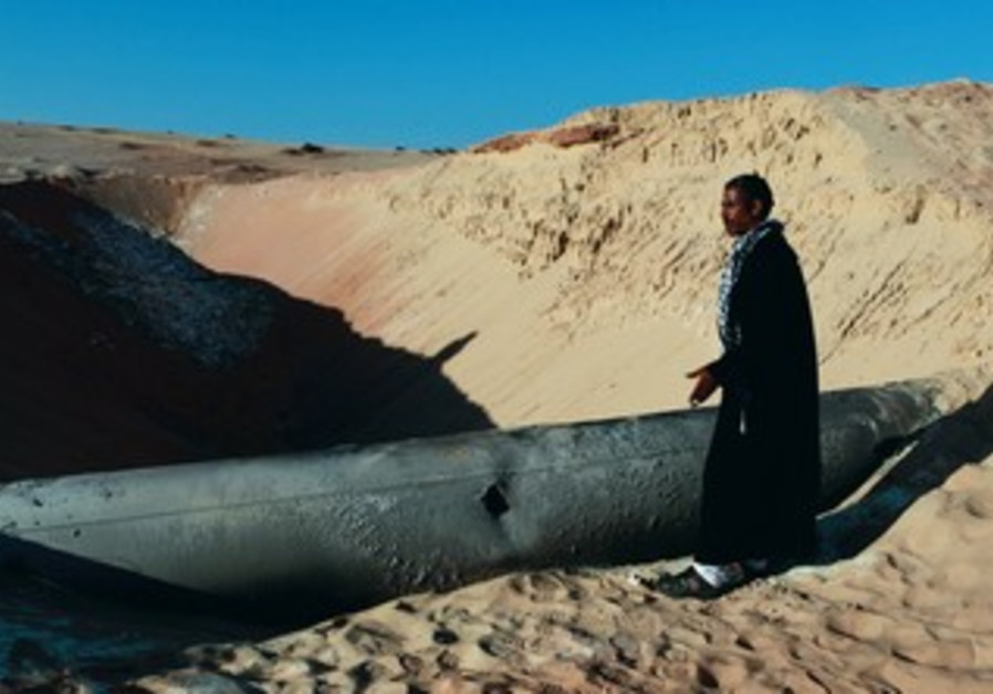 BEDUIN man looks at a gas pipeline in Sinai