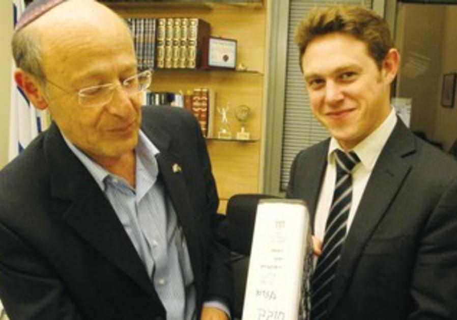 Jonathan Javor holds a bill  benefiting agunot