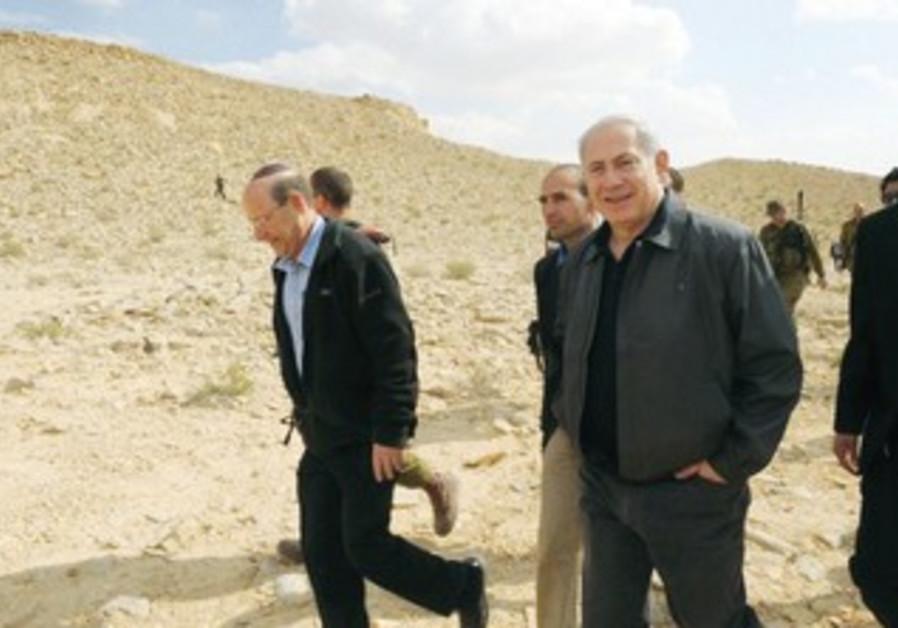 Otniel Schneller tours Egyptian border with Netany