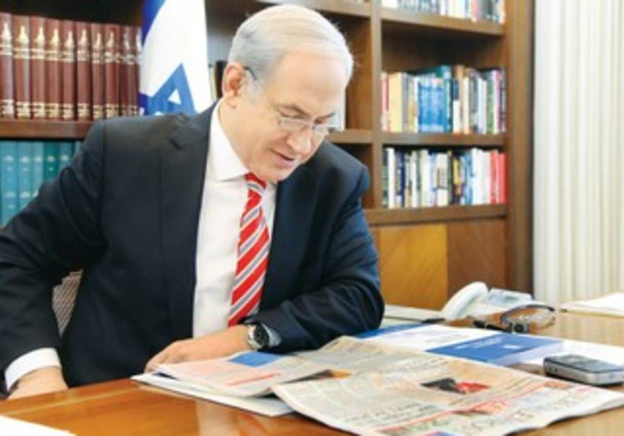 PM Netanyahu reading 'The Jerusalem Post' [file]