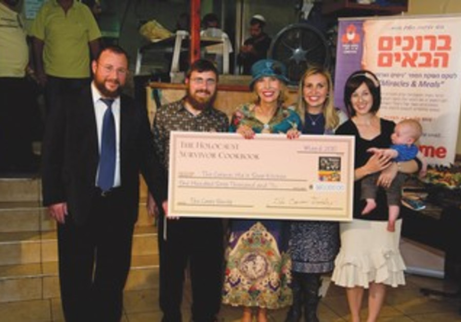 Presenting check to Carmei Ha'ir Soup Kitchen