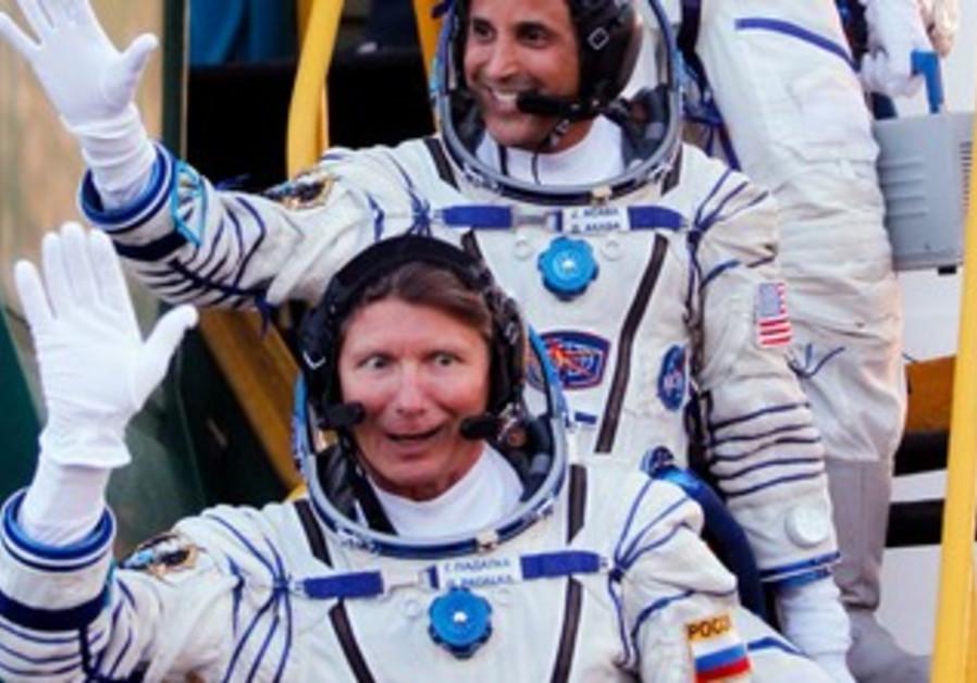 Astronauts suit up