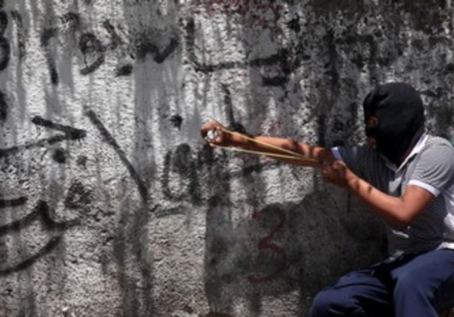 Palestinian fires sling shot [FILE]