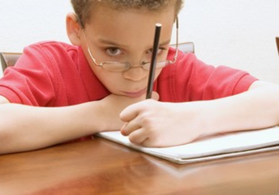 Boy reluctant to do his homework