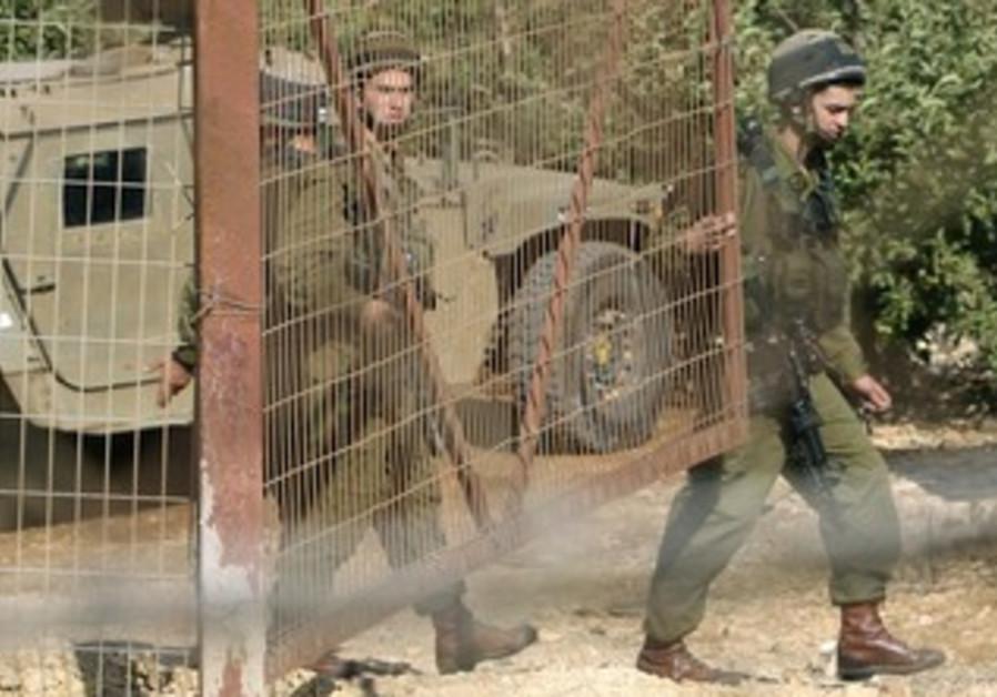 IDF soldiers close gate at Lebanon Border