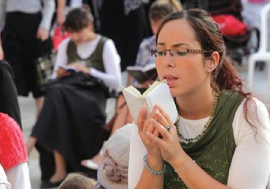 A woman prays at the Western Wall