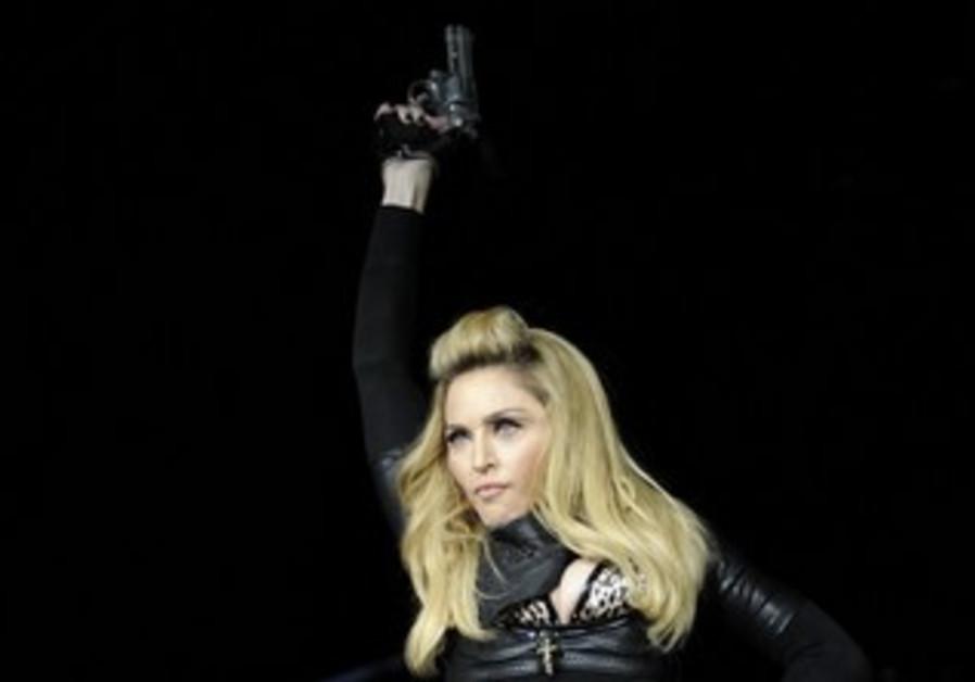Madonna with gun in MDNA tour