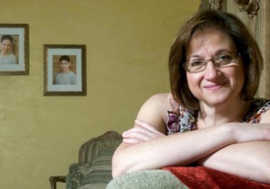 Cristina Iaboni poses at her home