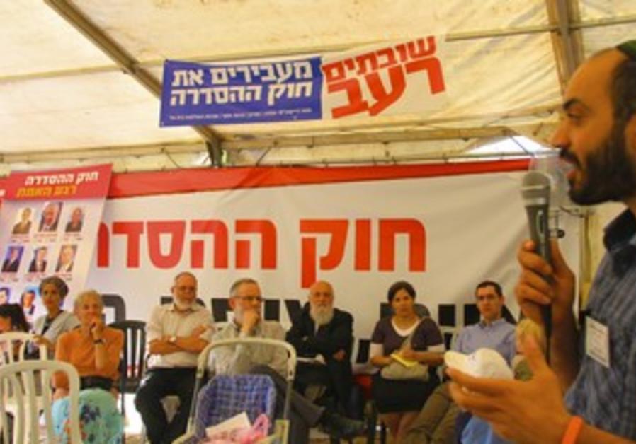 Activist Yehudah Yifrach at Ulpana protest tent