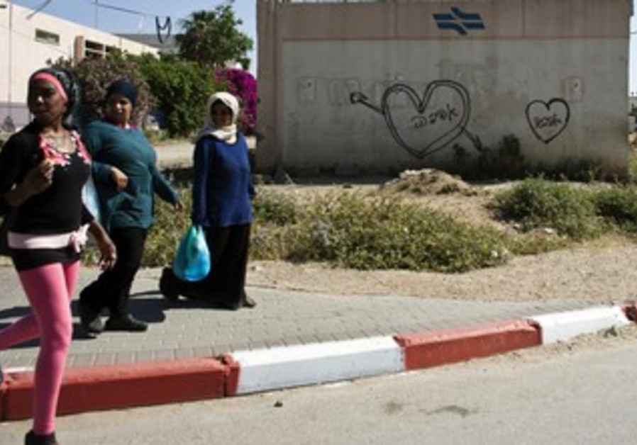 Women walking in the mixed Arab-Jewish city Lod