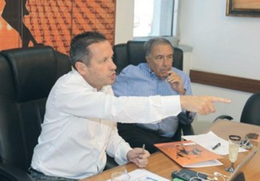 Avner Kopel (left) announces resignation