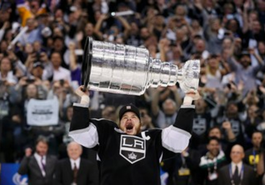 Kings right wing Dustin Brown hoists Stanley Cup