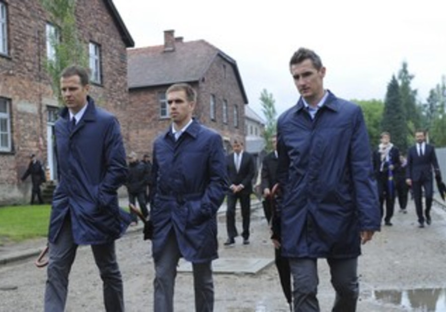 Germany's Bierhoff, Lahm, Klose at Auschwitz