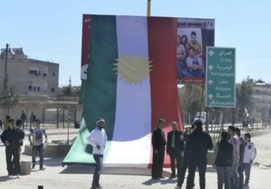 Kurds erect large Kurdistan flag in Syria protest