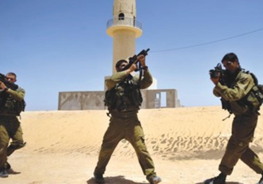 Soldiers take part in an urban warfare drill