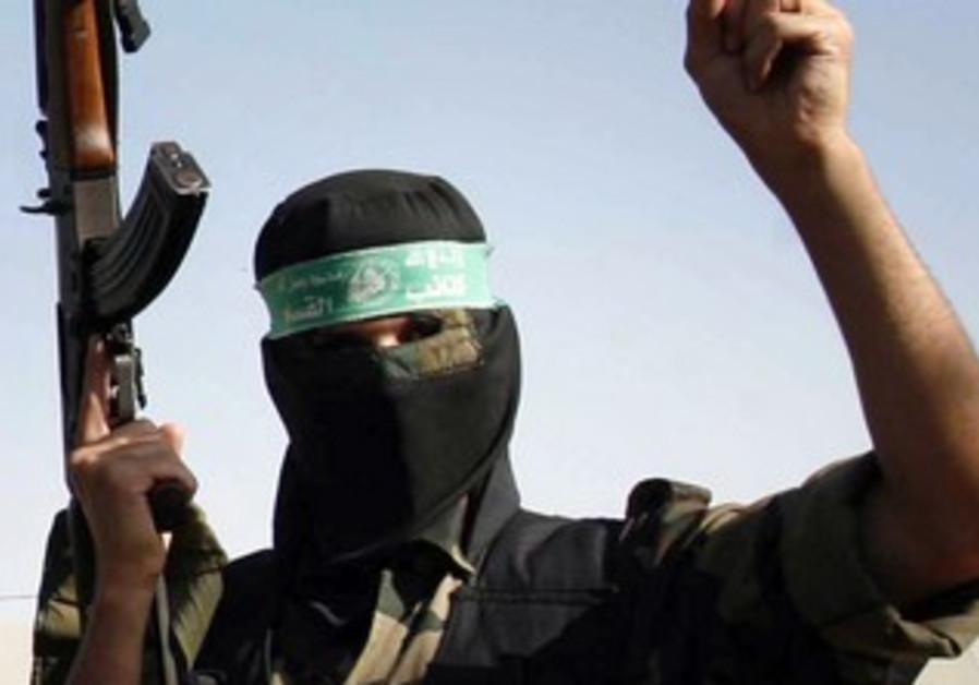 A masked Hamas man holds a gun [file]