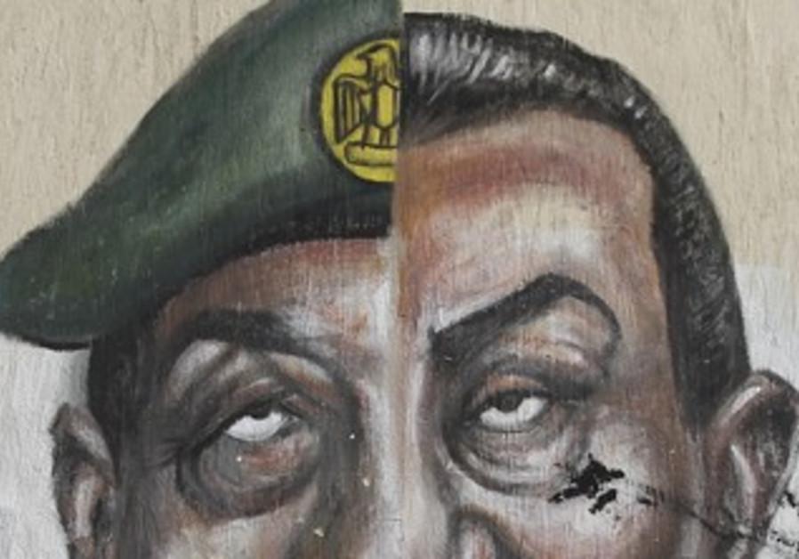 Spraypainted faces of Mubarak, Tantawi