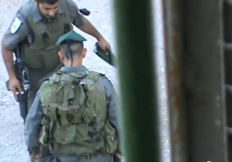 Border Police officers seen kicking Hebron child