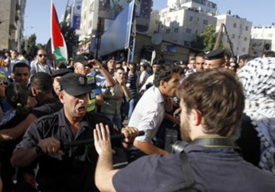 PA security forces scuffle with protesters