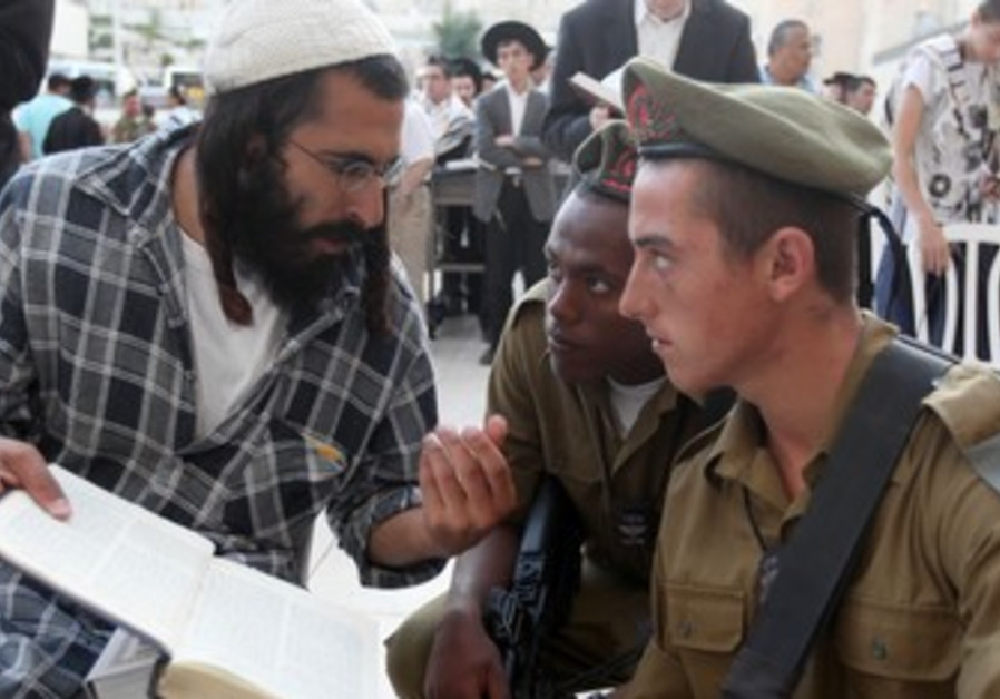 Orthodox man talks with soldiers.