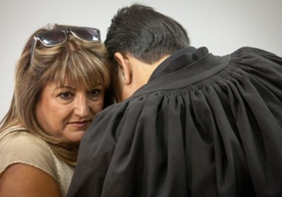 Shaula Zaken embraces lawyer