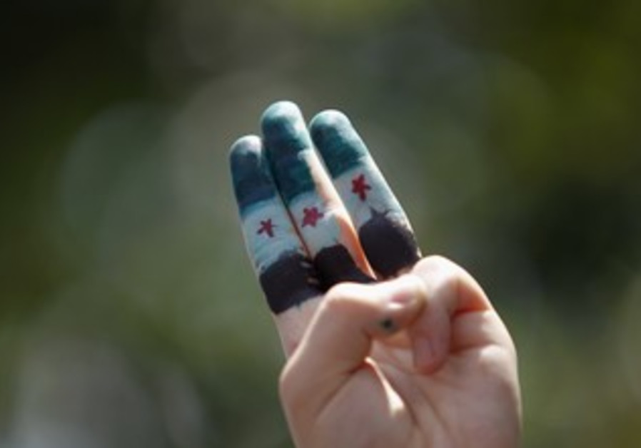 Syrian independence flag painted on fingers