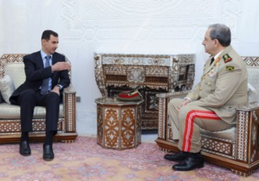Syria's Assad with Defense Minsiter Daoud Rajha