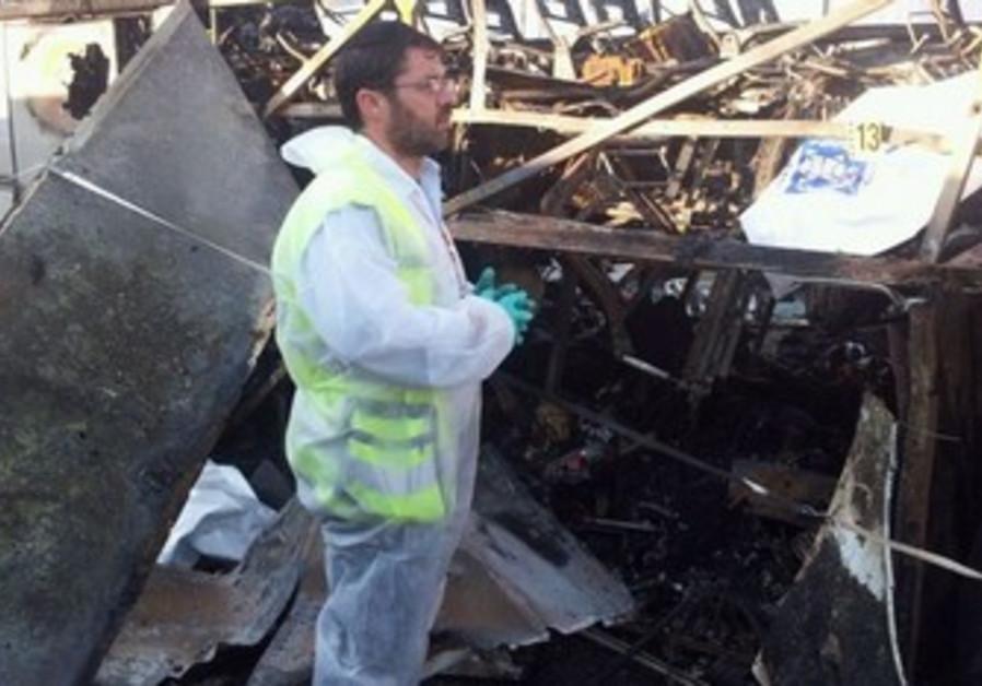 ZAKA man examines damage in Burgas