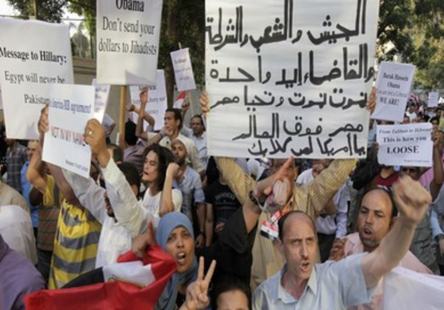 Protesters chant against Clinton's visit to Cairo