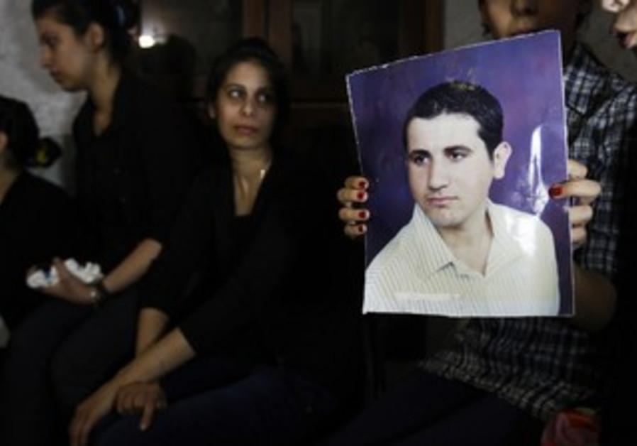 Palestinians show picture of convert in Gaza