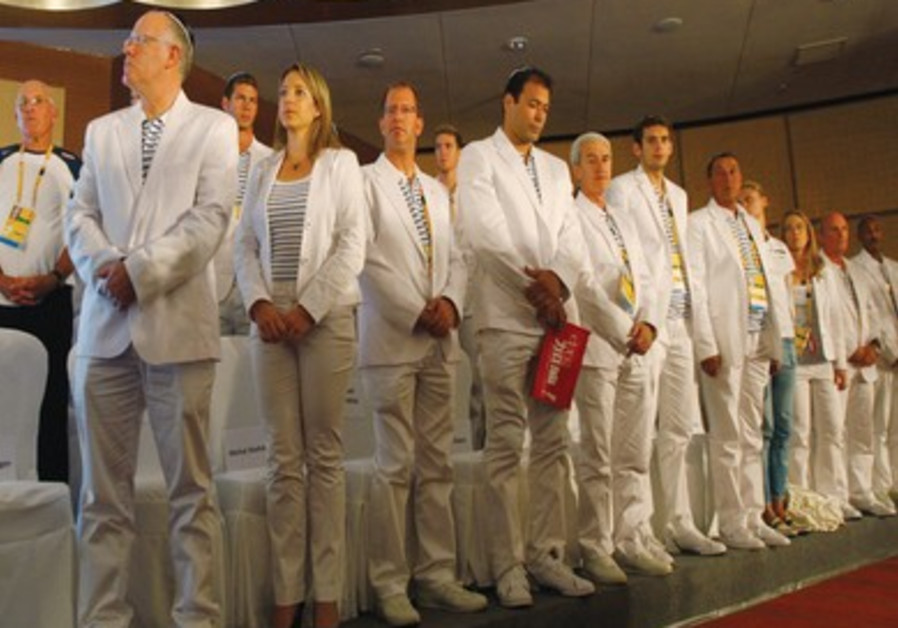 ISRAEL'S OLYMPIC team observes a minute of silence