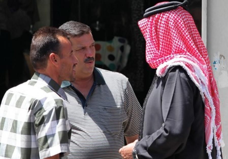 A group of Arab men talking