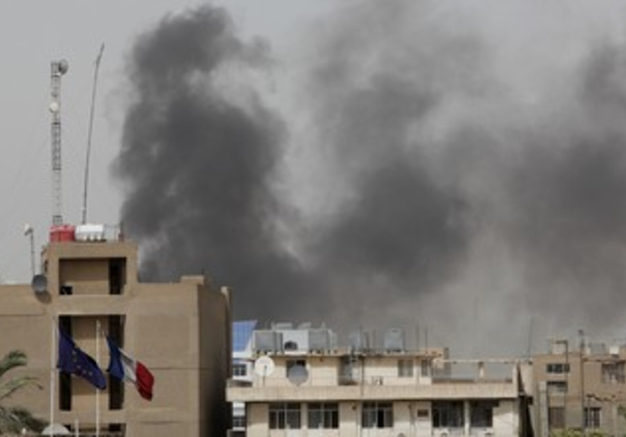 Smoke rises from site of a bomb attack in Baghdad