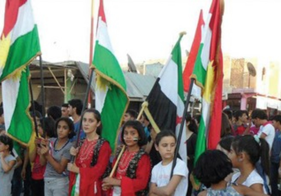 Kurdish and Syrian opposition flags