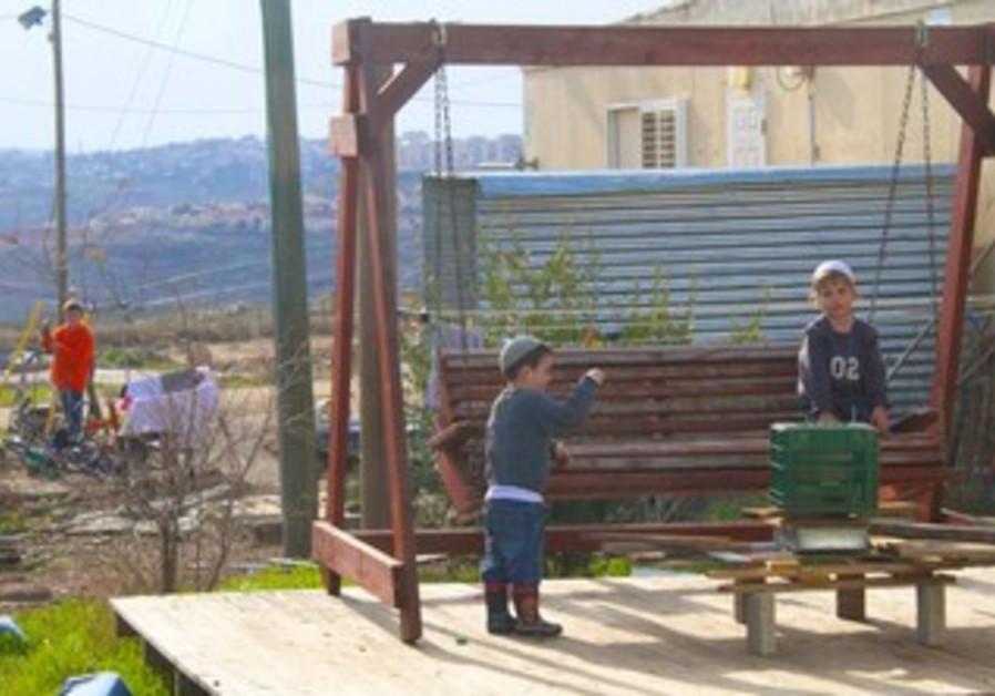 Jewish children play at Migron outpost