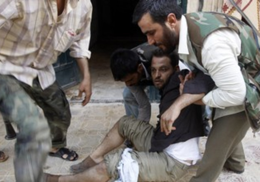 Medics Treat Wounded Free Syrian Army Fighter