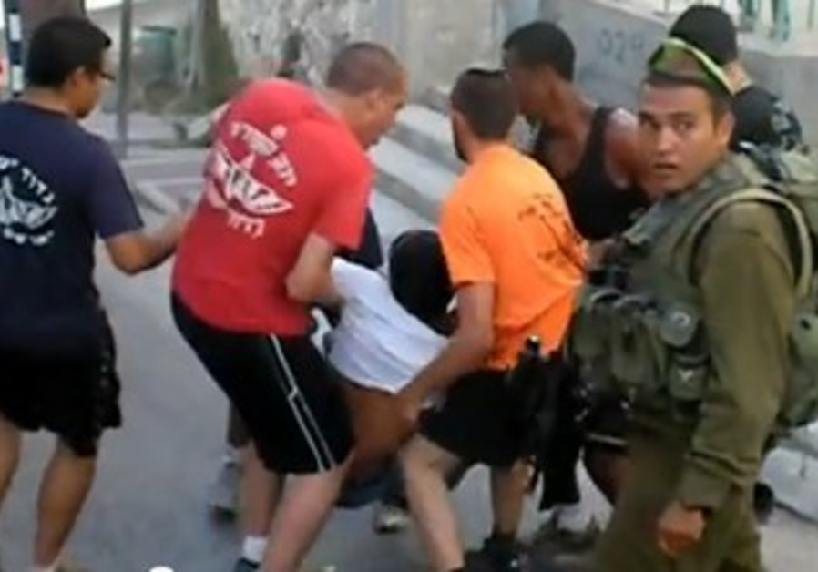 Out-of-uniform IDF soldiers clash with Palestinians in Hebron [file]